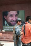 An Afghan National Police (ANP) paying his respects to Ahmad Shah Massoud.