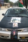 Parade vehicles decked out with pictures of Massoud.