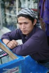 A mobile phone credit vendor and money-changer on the streets of Kabul
