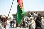 A demonstrator holding the Afghan flag.