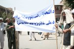 Demonstrators holding a banner in Kabul, Afghanistan.