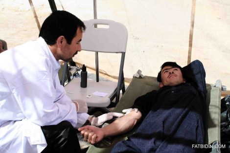A local Afghan donating blood.