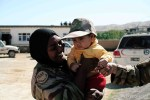 Capt. Dr Juhanis Safira Johari playing with a local Afghan baby.