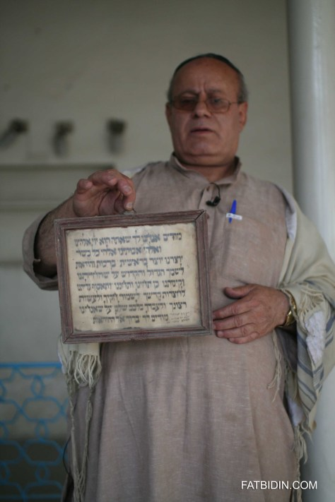 Zebolon Simantov, the last Jew in Afghanistan, holding an old jewish scripture.