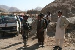 MALCON ISAF 2 commander, Lt. Col. Rusman Sanip, speaking to the local Afghans during a stop for provisions.