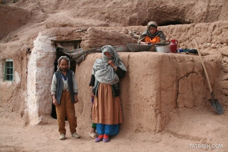 Mohammad Musa and his family outside his cave-house.