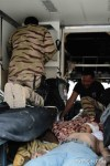 Major Dr Mohd Arshil Moideen & Corp Mohd Saiful Karim helping the injured Afghan National Police (ANP).