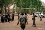 The students of Panjab High School playing volleyball with the men of MALCON ISAF 2.