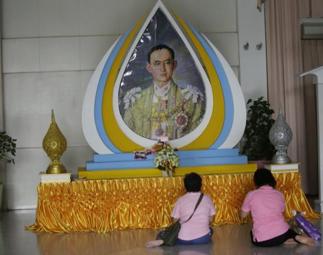 Thais pray in front of a portrait of Thai King Bhumibol Adulyadej in Bangkok, Thailand. Pic: AP