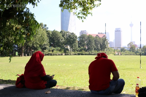 two-red-shirts-at-an-empty-padang-merbok-field-2